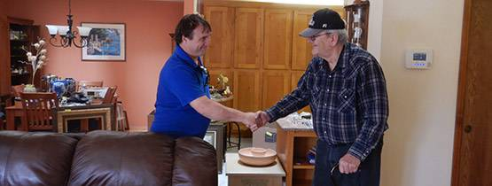 Lloyd shaking hands with a seller
